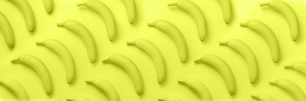 ネオンイエローパターン上のバナナ
