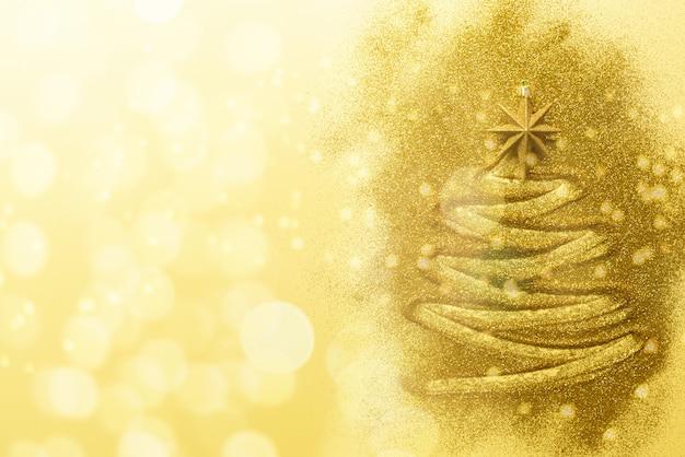 青の背景に輝くキラキラ星と輝くクリスマスツリー。