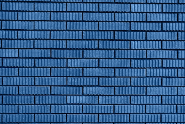 レンガの壁のテクスチャ。コピースペースの背景。トレンドのブルーと落ち着いたカラー。