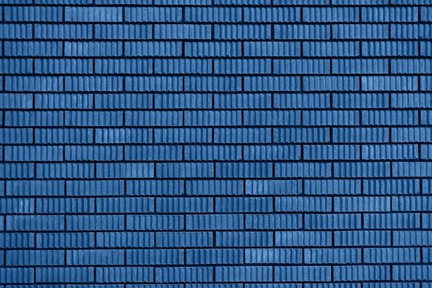 レンガの壁のテクスチャ。デザインのコピースペースの背景。トレンドのブルーと落ち着いたカラー。