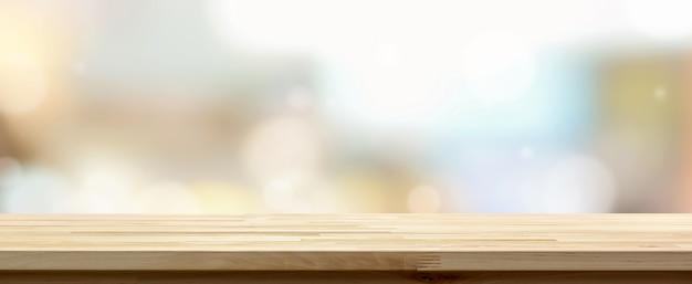 カフェの背景に対して木製テーブルトップ