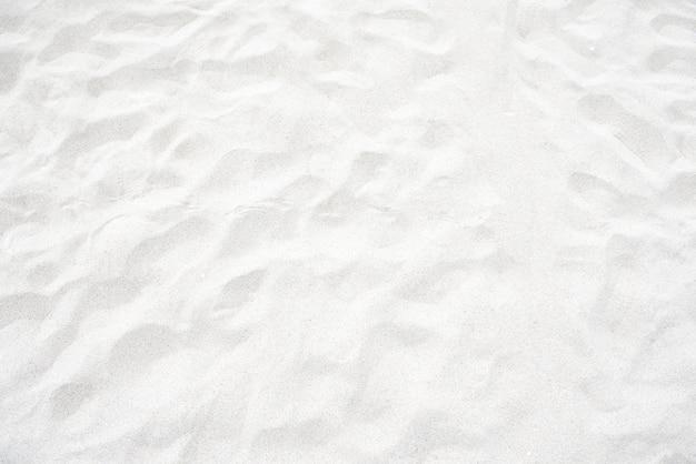 Текстура белого песка на пляже для фона
