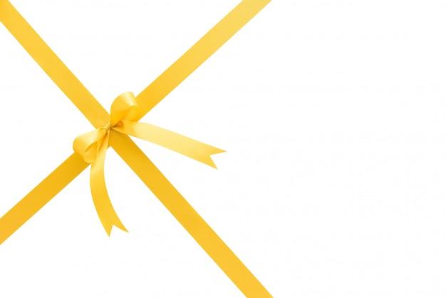 白い背景に弓と輝くお祝いサテン金黄色のリボン