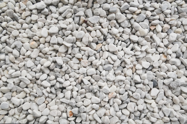 白い装飾的な小石のテクスチャ
