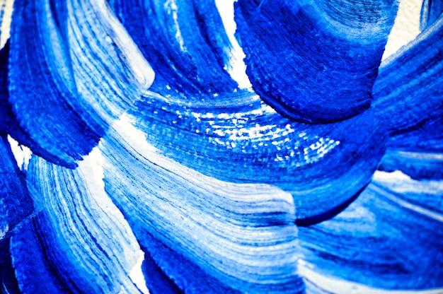 青い水彩画と抽象的なブラシストローク