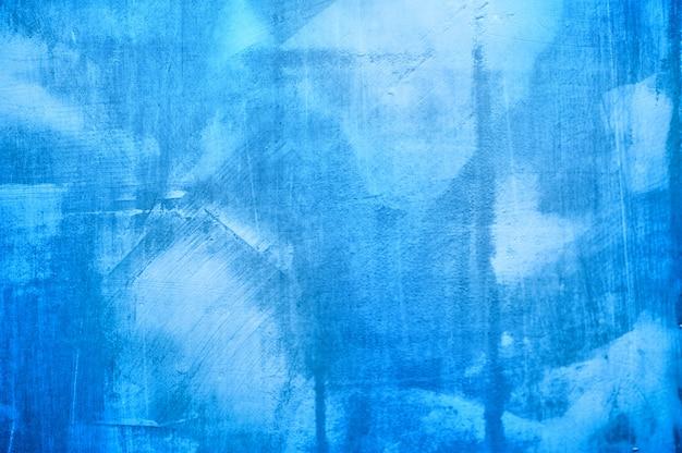 背景の壁に石膏の青いテクスチャ