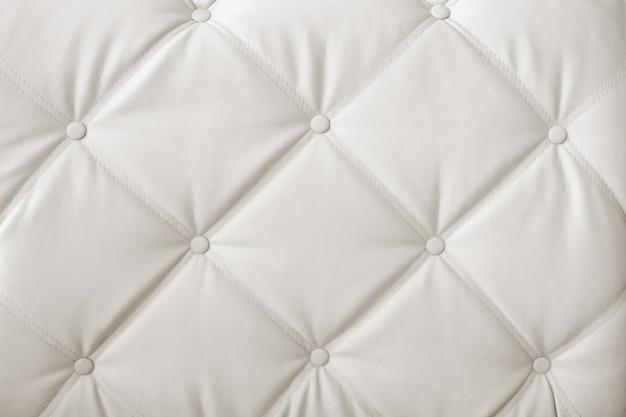 クラシックな白とグレーの革の質感を持つ豪華でモダンなスタイルの背景