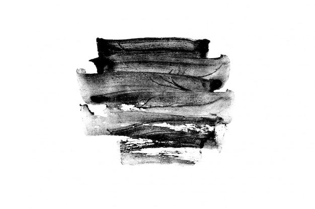Черные абстрактные мазки и брызги краски на бумаге. гранж-фон каллиграфии
