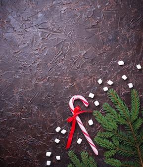 ペパーミント・キャンディ・ケーン。クリスマスのお祭りの背景