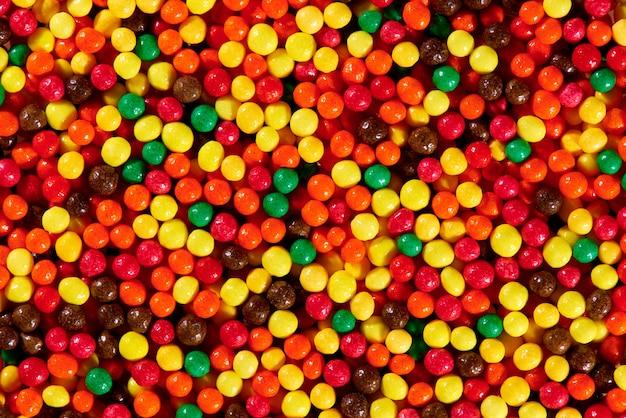 明るくカラフルなお菓子のクローズアップのバックグラウンドテクスチャ。