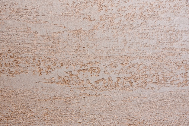 中立的な大まかなベージュの壁の背景。