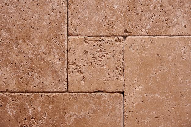 耐久性のあるタイルの背景の石の壁。