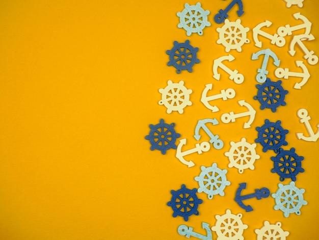 黄色の背景に、たくさんのアンカーと手の輪