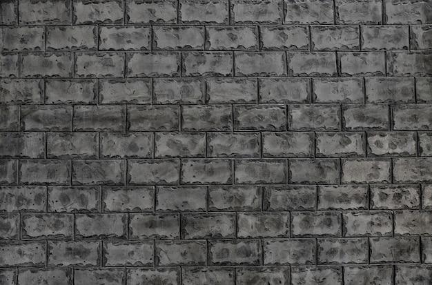 壁紙や品質の芸術のためのセメントレンガの壁のテクスチャ背景。