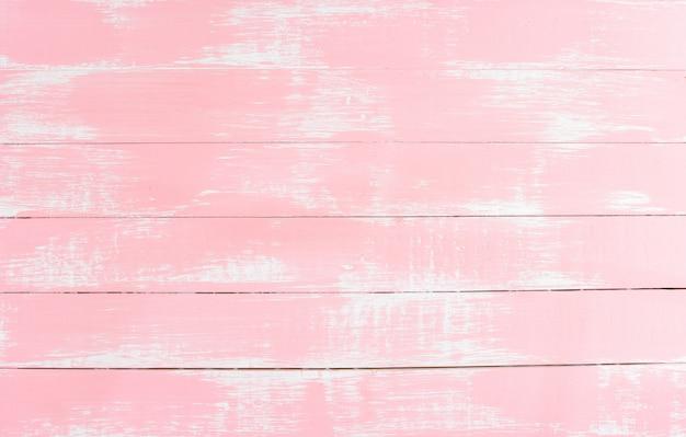 デザインアートワーク、壁紙の質感と品質の芸術のためのパステル調のピンクの木の板の背景色。