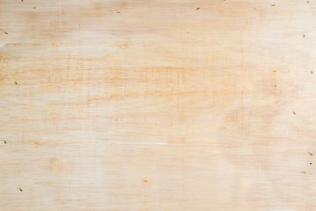 Светлая предпосылка текстуры деревянной доски с некоторой царапиной штапелей.