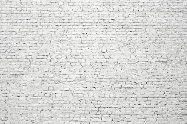 白いレンガの壁、石のブロックの古い表面の質感