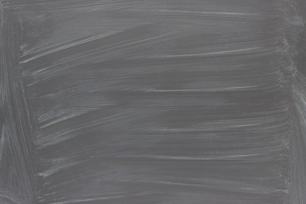 黒い黒板背景。チョークトレース付きテクスチャ黒板