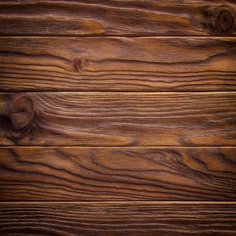 暗い古い木製のテーブルテクスチャ背景のトップビュー
