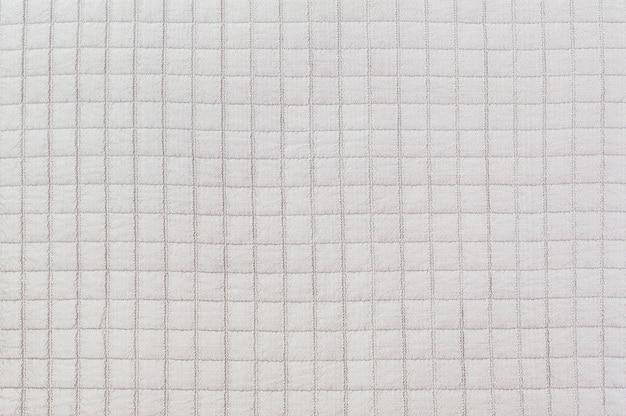 布のソファのテクスチャ背景でクローズアップ表面布パターン