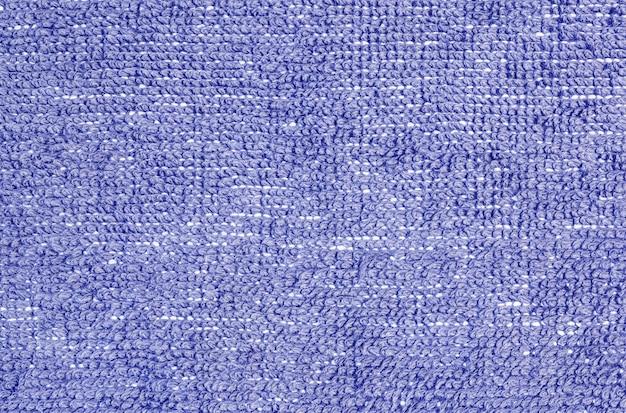家の質感の床に青い布マットでクローズアップ表面布パターン