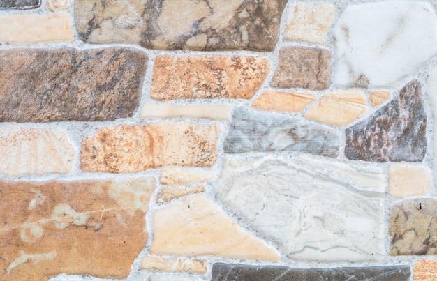 Крупным планом красивые каменные кирпичи стены текстуры