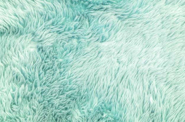 クローズアップ表面の緑の布のカーペットの質感