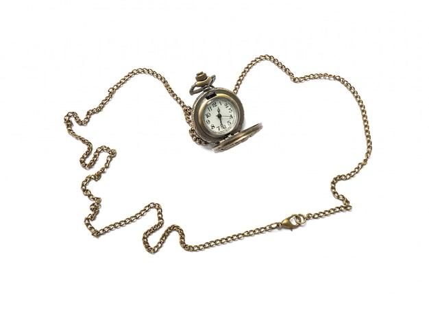 白で隔離されるクローズアップ真鍮時計ネックレス