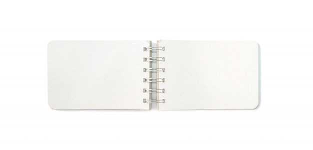 白い背景に分離された空白のクローズアップメモ帳