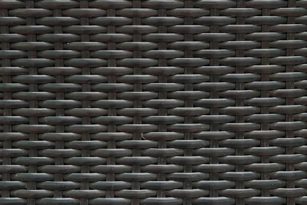 黒塗装木織り椅子テクスチャ背景でクローズアップ表面木目模様