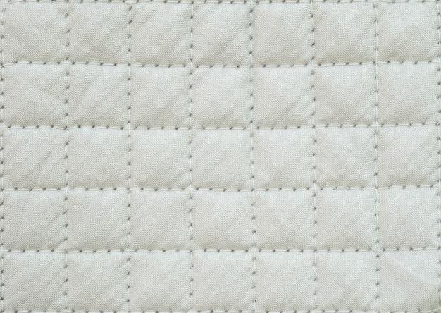 調理用の白い布オーブングローブでクローズアップ表面布パターン