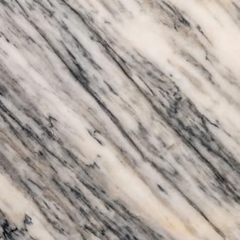 Крупным планом поверхности мрамора на фоне текстуры мраморной каменной стены
