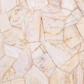 茶色の石レンガの壁のテクスチャ背景ビンテージトーンのクローズアップの表面石パターン