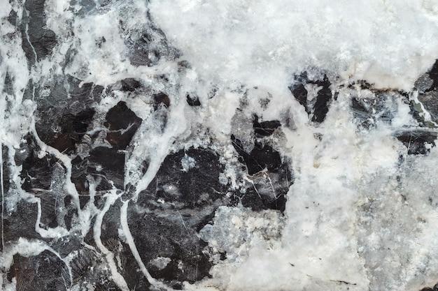 黒と白の大理石の石造りの壁テクスチャ背景でクローズアップ表面大理石パターン