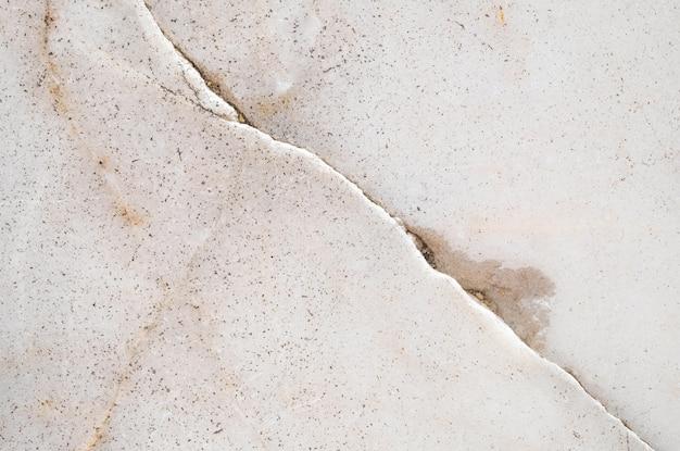 クローズアップの表面割れた大理石の床のテクスチャ背景