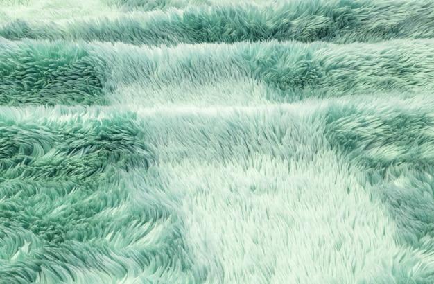 緑の布のカーペットでクローズアップ表面抽象的な布パターン