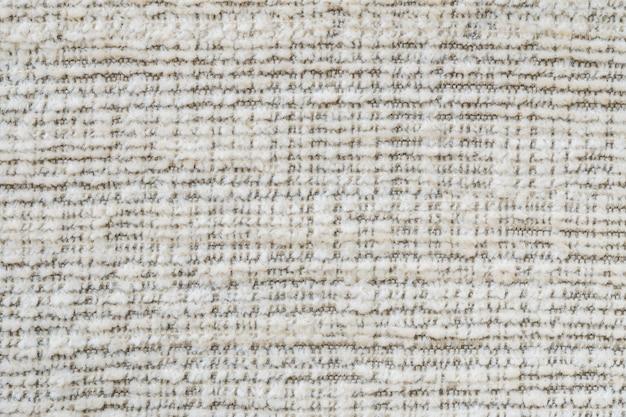 織り目加工の古い茶色の布のソファでクローズアップ表面布パターン