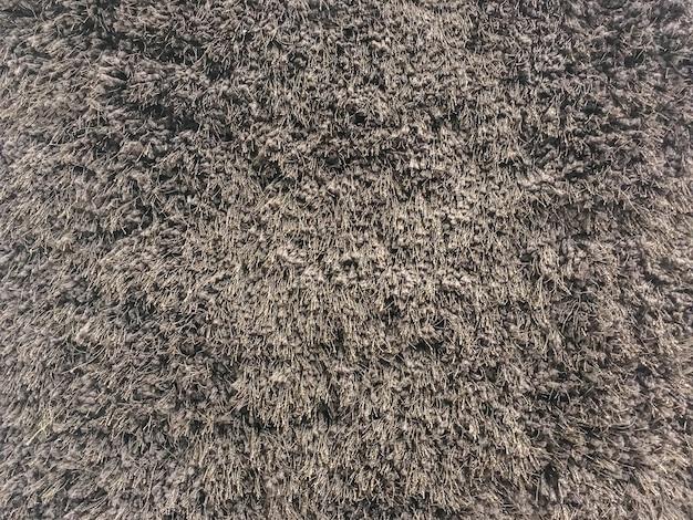 床のテクスチャ背景でクローズアップ表面茶色布カーペット