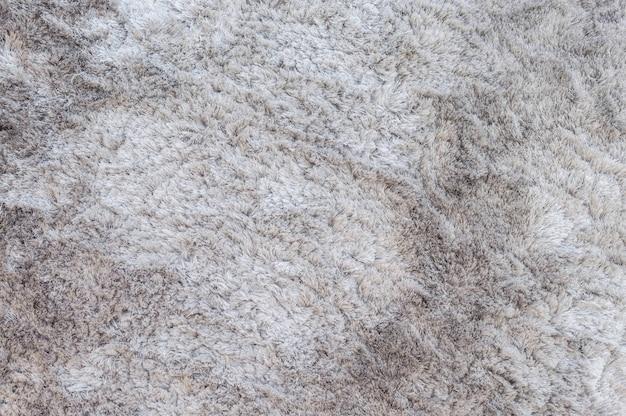 クローズアップ表面の灰色のカーペットのテクスチャ背景
