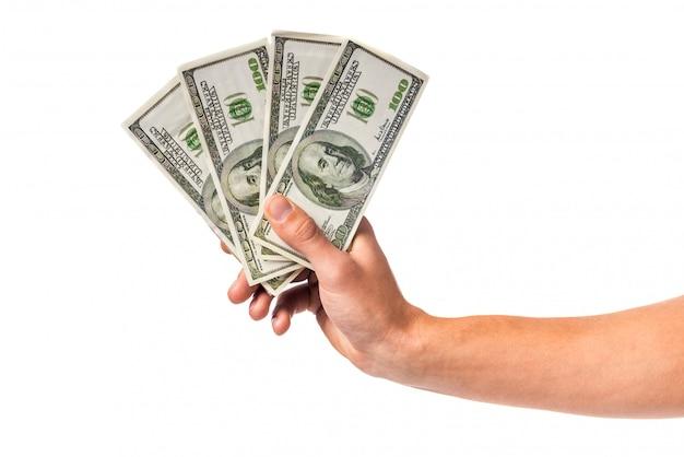 お金の現金を持っている男性の手
