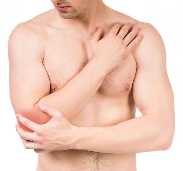肘の痛みと若い男