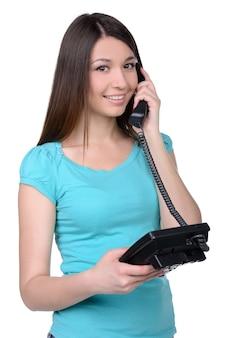 こんにちは!電話で話していると笑顔の美しい若い女性。