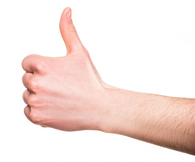 男性の手のクローズアップは親指を現しています。