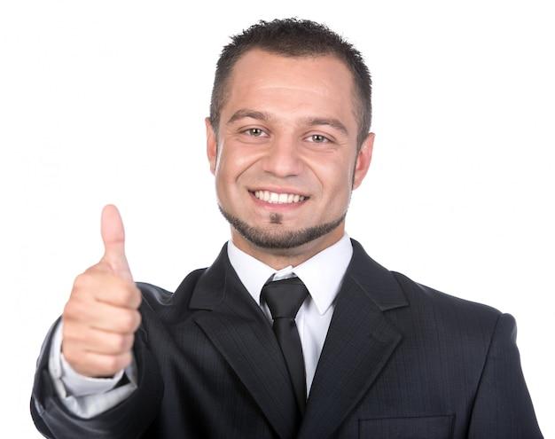 分離されたスーツを着た若い男の笑みを浮かべてください。