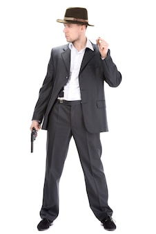 Мужчина в шляпе и с пистолетом