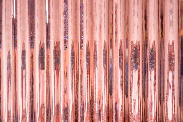 ホログラムの抽象的なオレンジ色の背景。ホログラフィックカラーしわのホイル。虹色のアート。トレンディなぼやけた背景。