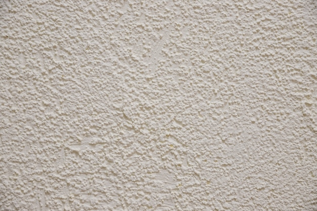 ベージュ色のセメントの壁のテクスチャ。鋭いコンクリートの壁紙の背景。ベージュ色の背景。コンクリートの壁。