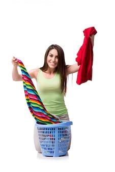 汚れた洗濯をした後に悩んでいる女性
