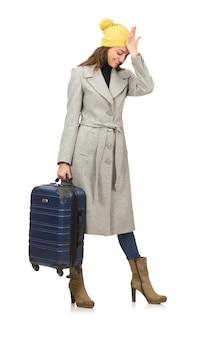 冬の休暇の準備ができてのスーツケースを持つ女性