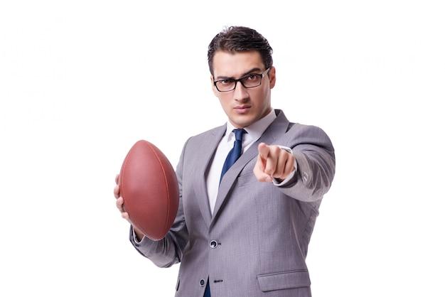Бизнесмен с американским футболом на белом фоне